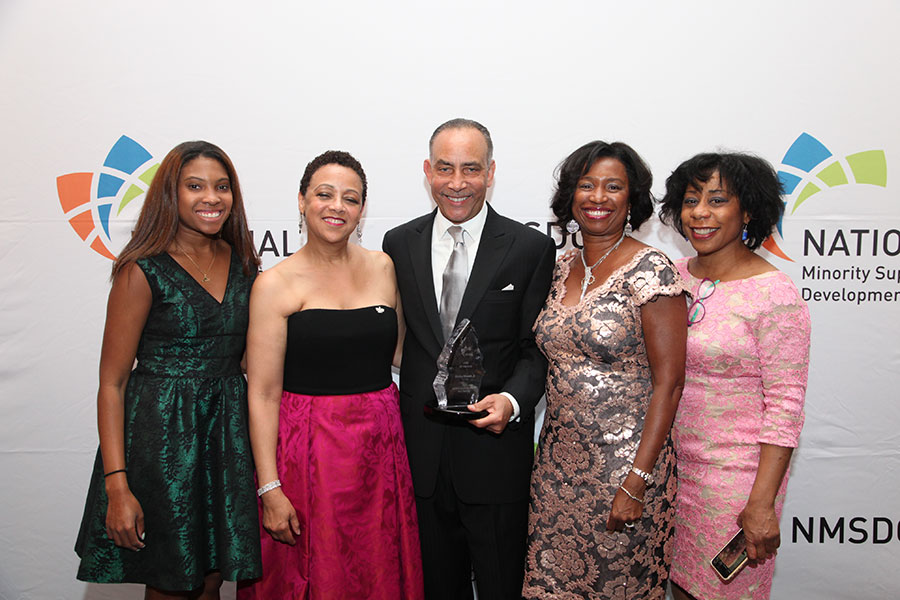 NMSDC President Joset Wright-Lacy with 2015 CPO of the Year Award Honoree Shelley Stewart, Jr. alongside guests.