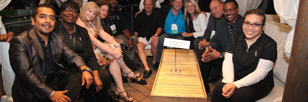 Conference attendees at the Sand and Surf Reception