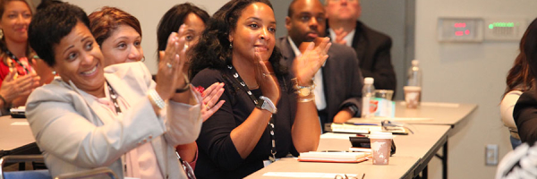 """Attendees applaud at the """"Leadership DNA: Where Does Leadership Start?"""" Workshop"""