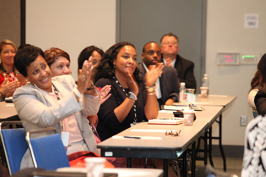 "Attendees applaud at the ""Leadership DNA: Where Does Leadership Start?"" Workshop"