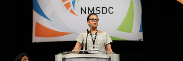 Joset Wright-Lacy, President, NMSDC, welcomes guests at the Monday Power Breakfast