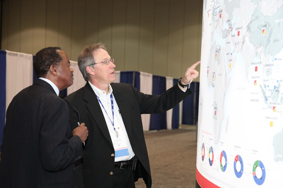 Conference attendees check out a world map at the Business Opportunity Fair.