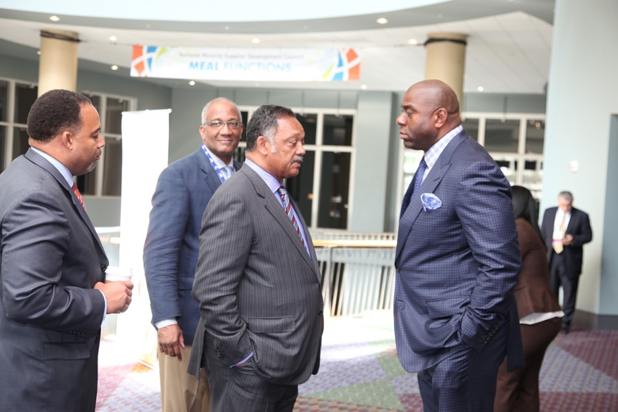 "Reverend Jesse Jackson (left) shares a private moment with Earvin ""Magic"" Johnson before the Monday luncheon."
